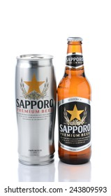 IRVINE, CA - JANUARY 12, 2015: A can and bottle of Sapporo Beer on white. The Japanese brewery was founded in 1876 by German trained brewer Seibei Nakagawa. It is the oldest beer brand in Japan.