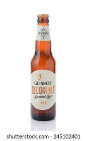 IRVINE, CA - JANUARY 12, 2015: A single bottle of Guinness Blonde American Lager isolated on white. Guinness has been producing beer in Ireland since 1759.