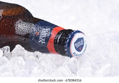 IRVINE, CA - JULY 16, 2017: Samuel Adams beer bottle closeup on ice. From the Boston Beer Company. Based on sales in 2016, it is the second largest craft brewery in the U.S.
