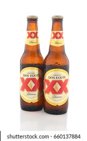 IRVINE, CA - JUNE 14, 2017: Dos Equis Blanca. Two bottles of the wheat beer from Cuauhtemoc-Moctezuma Brewery in Monterrey, Mexico a subsidiary of Heineken International.