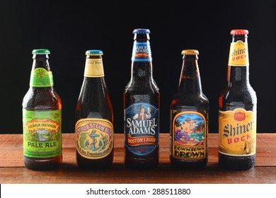 IRVINE, CA - JUNE 18, 2015: A variety of popular domestic beer brands. Five brands including Samuel Adams, Anchor Steam, Sierra Nevada, Downtown Brown and Shiner Bock