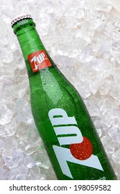 "IRVINE, CA - JUNE 9, 2014: Closeup of a bottle of 7UP lemon lime soda in ice. The product, originally named ""Bib-Label Lithiated Lemon-Lime Soda"" was introduced in 1929."