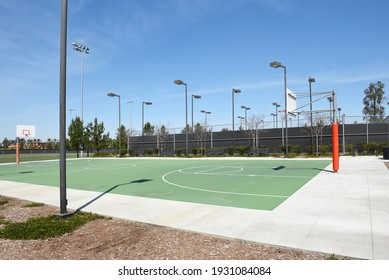 IRVINE, CA - MARCH 24, 2017: Cypress Community Park Basketball and Tennis courts. The 17.9 acre park is part of a master-planned balance of urban living and preserved natural space.