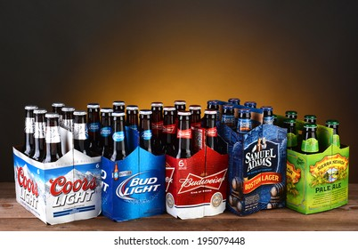 IRVINE, CA - MAY 25, 2014: Five 6 packs of Domestic Beers. Five of the most popular Imported beer brands: Coors Light, Bud Light, Budweiser, Samuel Adams and Sierra Nevada on wood table.