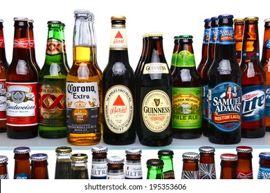 IRVINE, CA - MAY 25, 2014: A variety of beer brands on shelves. Many brands including domestic and import beers are shown including, Corona, Guinness, Budweiser, Coors, Bass and Sam Adams.