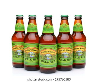 IRVINE, CA - MAY 25, 2014: Five bottles of Sierra Nevada Pale Ale on white. Sierra Nevada Brewing Co. was established in 1980 by homebrewers in Chico, California,