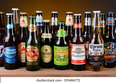 IRVINE, CA - MAY 26, 2014: A variety of popular beer brands. Many brands including domestic and import beers are shown including, Corona, Guinness, Budweiser, Coors Bass and Sam Adams.