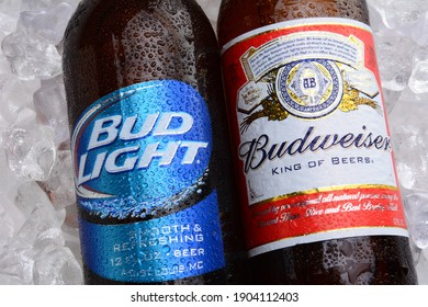 IRVINE, CA - MAY 27, 2014: A bottle of Budweiser and Bud Light on a bed of ice. From Anheuser-Busch InBev, Budweiser and Bud Light are top selling domestic beers in the United States.