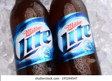 IRVINE, CA - MAY 27, 2014: Two bottles of Miller Light on a bed of ice. Introduced in 1975 Miller Lite was one of the first Reduced Calorie beers to be successful in the American marketplace.
