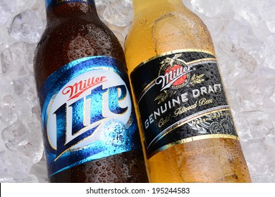 IRVINE, CA - MAY 27, 2014: A bottle of MGD and Miller Lite on a bed of ice. Miller Genuine Draft and Miller Lite are two popular domestic beers in the United States.