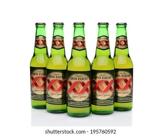 IRVINE, CA - MAY 27, 2014: Five Bottles of Dos Equis Lager Especial on white. Founded in 1890 from the Cuauhtemoc-Moctezuma Brewery in Monterrey, Mexico a subsidiary of Heineken International.