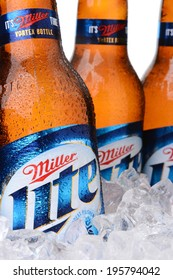 IRVINE, CA - MAY 30, 2014: Closeup of Miller Light beer bottles in ice. Introduced in 1975 Miller Lite was one of the first Reduced Calorie beers to be successful in the American marketplace.