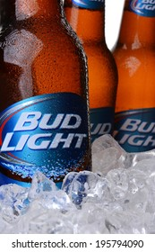 IRVINE, CA - MAY 30, 2014: Closeup of three Bud Light Beer Bottles in ice. From Anheuser-Busch InBev, Bud Light is the top selling domestic beer in the United States.