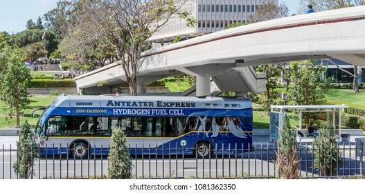 Irvine, CA, USA - April 16, 2018: University of California Irvine Anteater Express bus parked at campus stop. School vehicles are eco friendly, running on hydrogen fuel cells and boast zero emissions.