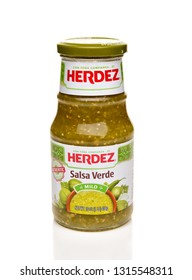 IRVINE, CALFORNIA - FEBRUARY 17, 2019:  A 16 ounce jar of Herdez Salsa Verde. herdez in one of the top slasa brands oin Mexico.