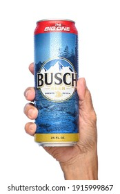 IRVINE, CALIFORNIA - APRIL 26, 2019: Closeup of a hand holding a 25 ounce King Can of Busch Beer. An economy brand pale lager introduced in 1955 as Busch Bavarian Beer.