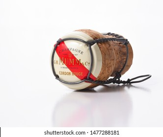IRVINE, CALIFORNIA - AUGUST 12, 2019: G. H. Mumm Champagne cork closeup on white with reflection.
