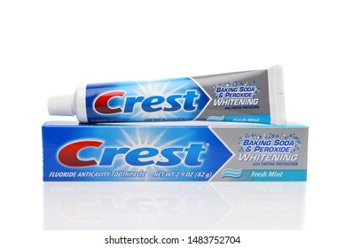 IRVINE, CALIFORNIA - AUGUST 20, 2019: A tube of Crest Flouride Anticavity Whitening Toothpaste with Baking Soda and Peroxide, Fresh Mint flavor.