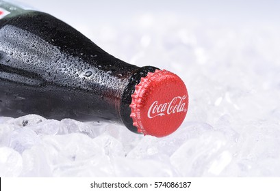 IRVINE, CALIFORNIA - FEBRUARY 7, 2017: Coca-Cola Bottle on ice. Introduced in 1886, the Atlanta based soft drink manufacturers products are available in 200 countries.