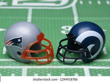 IRVINE, CALIFORNIA - January 25, 2019: Football helmets of the New England Patriots and Los Angeles Rams, opponents in the LIII Super Bowl, on a field background.