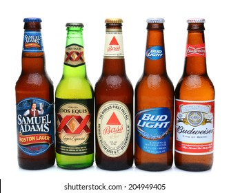 IRVINE, CALIFORNIA - JULY 14, 2014: 5 bottles of assorted cold beers. Domestic and Imported brews including, Budweiser, Bud Light, Bass, Dos Equis and Samuel Adams.