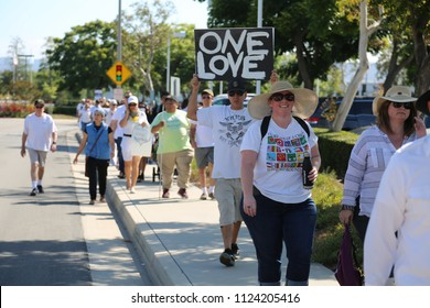 IRVINE, CALIFORNIA - June 30, 2018: Keeping Families Together. People march, hold signs, chant slogans, & protest to stop the administration from separating families who cross the boarder illegally.