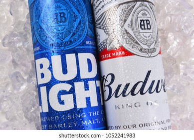 IRVINE, CALIFORNIA - MARCH 21, 2018: Budweiser and Bud Light King Cans on ice closeup. Budweiser and Bud Light are two of the most popular beers in the U.S.