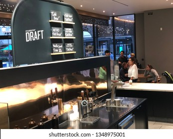 Irvine, California: March 24, 2019:   A Starbucks retail store at the Irvine Spectrum. Starbucks is a multinational coffee company.