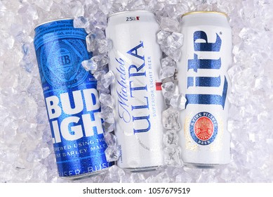 IRVINE, CALIFORNIA - MARCH 29, 2018: Three of the most popular Light beers in a bed of ice. King cans of Bud Light, Michelob Ultra, and Miller Lite.