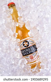 IRVINE, CALIFORNIA - MARCH 29, 2018: Closeup of a bottle of Estrella Jalisco beer in ice.  Estrella Jalisco is a American Lager style beer brewed by Grupo Modelo.