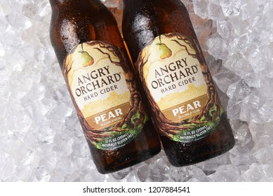 IRVINE, CALIFORNIA - OCTOBER 19, 2018: Two Bottles of Anrgy Orchard Pear Hard Cider on a bed of ice.