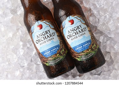 IRVINE, CALIFORNIA - OCTOBER 19, 2018: Two bottles of Anrgy Orchard Crisp Apple Hard Cider on a bed of ice.