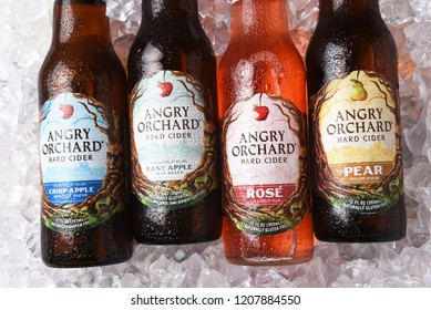 IRVINE, CALIFORNIA - OCTOBER 19, 2018: Four bottles of Anrgy Orchard Hard Cider on a bed of ice. Apple, Pear and Rose varieties are shown.