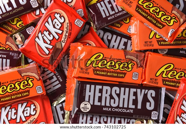 IRVINE, CALIFORNIA - OCTOBER 27, 2017: A variety of Hersheys Candy Bars. The full size candy bars are a favorite at Halloween.