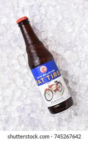 IRVINE, CALIFORNIA - OCTOBER 30, 2017: Fat Tire Amber Ale on ice. A bottle of Fat Tire Amber Ale from the New Belgium Brewing Company, of Fort Collins, Colorado.
