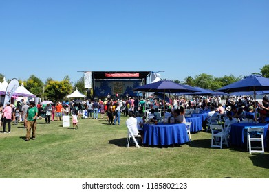 IRVINE, CALIFORNIA - SEPT 22, 2018: Michael Jackson impersonator performs at the Irvine Global Village while guest mingle and enjoy food from local vendors.