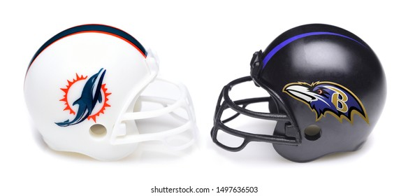 IRVINE, CALIFORNIA - SEPTEMBER 6, 2019: Football helmets of the Miami Dolphins vs Baltimore Ravens, Week One opponents in the NFL 2019 Season