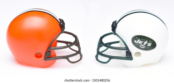 IRVINE, CALIFORNIA - SEPTEMBER 6, 2019: Football helmets of the Cleveland Browns vs New York Jets, Week 2 opponents in the NFL 2019 Season, Monday Night Football Game.