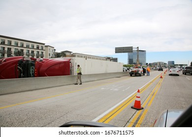 Irvine, California / USA - March 18, 2020: Semi Truck and Cargo on its side on the freeway after an accident in Irvine California. Traffic is Diverted and causing Traffic Jams due to an accident.