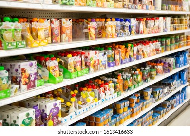 Irvine, California/United States - 01/04/2020: An aisle full of several varieties of baby juice pouches on display at a local grocery store.