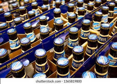 Irvine, California/United States - 03/29/19: A background full of Blue Moon bottled beer on a shelf at the grocery store