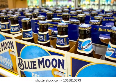 Irvine, California/United States - 03/29/19: Several six pack cases of Blue Moon beer on a shelf at a grocery store