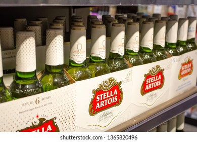 Irvine, California/United States - 03/29/19: Several six pack cases of Stella Artois bottled beer on a shelf at the grocery store