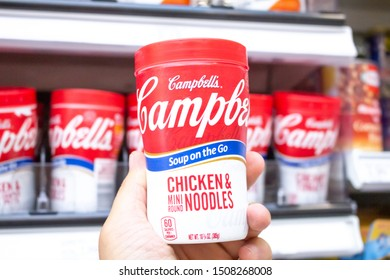 Irvine, California/United States - 08/09/2019: A hand holds a can of Campbell's soup