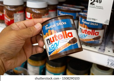Irvine, California/United States - 08/09/2019: A hand holds a Nutella and pretzels snack container at the grocery store