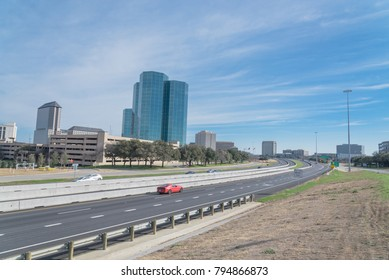 Irving, Texas skyline view from John Carpenter Freeway under winter cloud blue sky. Cityscape and transportation background.