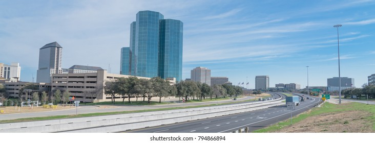 Irving, Texas skyline view from John Carpenter Freeway under winter cloud blue sky. Cityscape and transportation background. Panorama style.