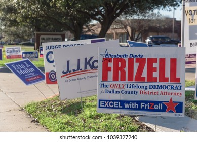 IRVING, TEXAS, USA-MAR 2, 2018: Yard sign at residential street near library for primary election day in Dallas county. Close-up of signs greeting early voters.