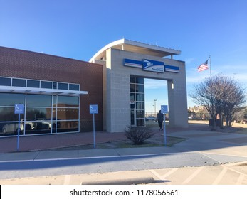 IRVING, TX, USA-FEB 2, 2018:Customer enter entrance exterior of USPS store winter afternoon. The United States Postal Service is an independent agency of US federal government providing postal service