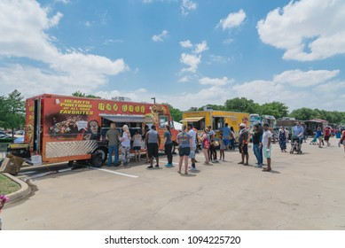 IRVING, TX, USA-MAY 19, 2018:Food truck vendor customer buy and taste variety of food at The Taste of Irving 2018 event. An outdoor festival featuring family-friendly activities, live music and food